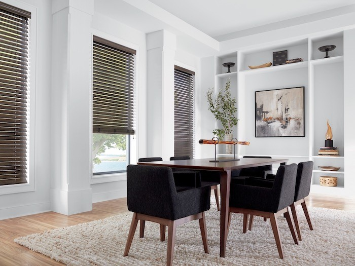 A dining room with a textured area rug.